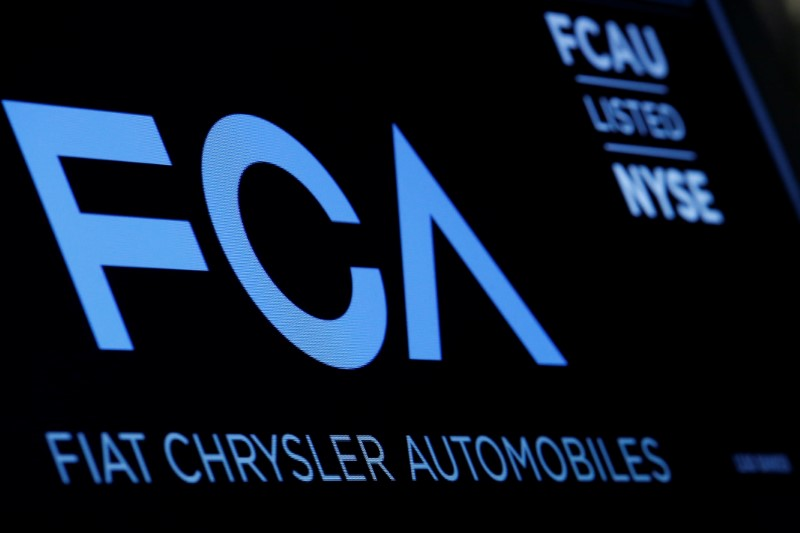 FILE PHOTO: A screen displays the ticker information for Fiat Chrysler Automobiles NV at the post where it's traded on the floorof the NYSE